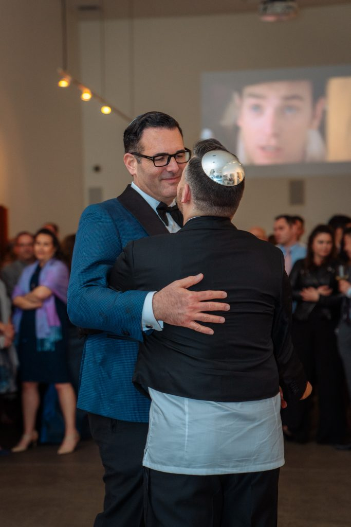Biro & Sons' client Ennis Olson dances with his partner showing off his stunning sterling silver kippah.
